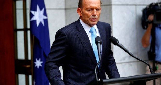 Australia's Prime Minister Tony Abbott addresses members of the media after a party room meeting at Parliament House in Canberra February 9, 2015. Abbott survived a challenge to his leadership after his ruling Liberal Party on Monday voted down an attempt to unseat him after weeks of infighting. A secret party room ballot to declare the positions of party leader and deputy leader vacant was voted down 61 votes to 39, chief party whip Philip Ruddock told reporters.  REUTERS/Sean Davey  (AUSTRALIA - Tags: POLITICS)