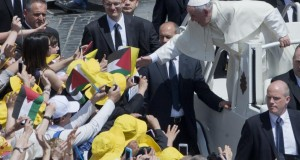 Pope Francis greets faithful in St. Peter's Square at the Vatican, Sunday, May 17, 2015. Pope Francis canonized two nuns from what was 19th century Palestine on Sunday in hopes of encouraging Christians across the Middle East who are facing a wave of persecution from Islamic extremists. Sisters Mariam Bawardy and Marie Alphonsine Ghattas were among four sisters who were made saints Sunday at a Mass in a sun-soaked St. Peter's Square. (AP Photo/Alessandra Tarantino)
